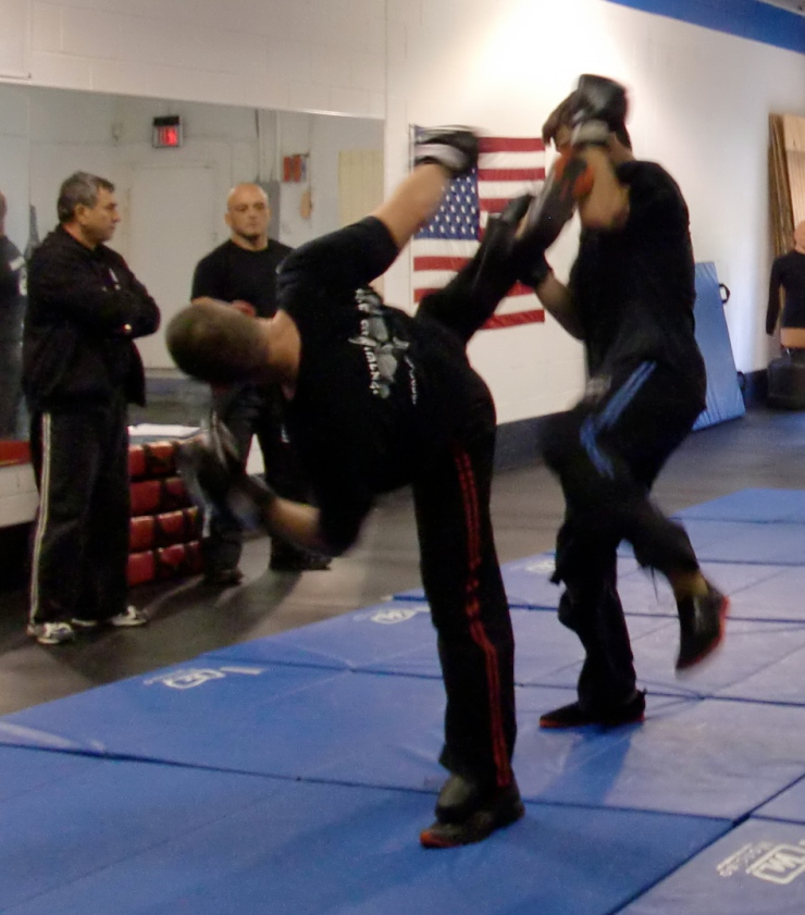 Instructor Dave Ordini with instructor Jason B. with Grandmaster Hiam and Yigal in background
